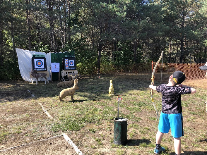 Blake Arbuckle shooting a bow and arrow, his favourite part of last year's Fall Fair and he couldn't wait to come back for round two