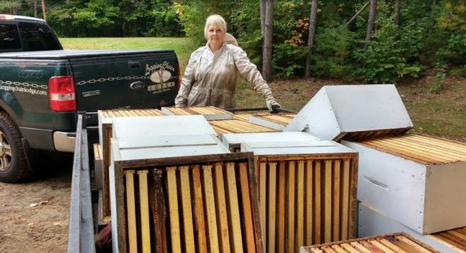 Annmarie Boehm-Tapley with racks from some of the Muskoka Honey Bee hives (supplied)
