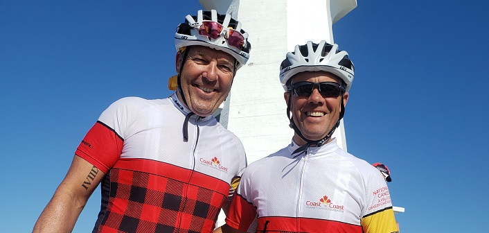 Paul Stevens (left) and Jeff Taylor at the Peggy's Cove lighthouse in Nova Scotia (supplied)
