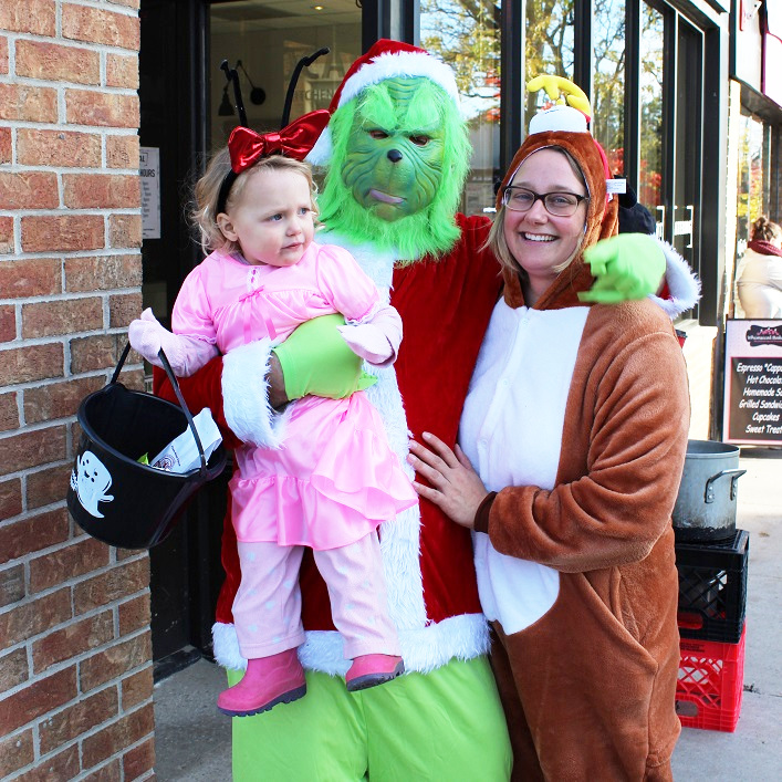 The Grinch (a.k.a. Gavin Bennett) brought some Christmas uncheer to Main Street along with Cindy Lou Who (Vixen Bennett) and Max (Kat Andersen)