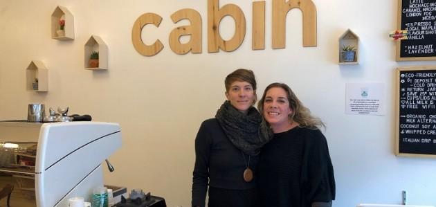 Anna Smith (right), owner of Cabin Organic Café, with Keri-Lyn Freebird (Sydney Allen)