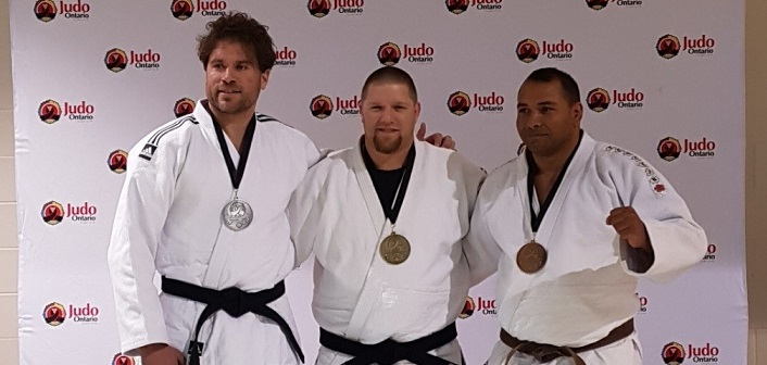 Jeff Allen (centre) with a gold from the Hatashita Ontario Open in Toronto (supplied)