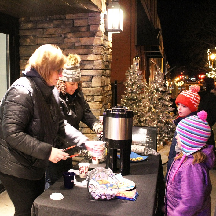 Coldwell Banker Thompson was one of several businesses to offer warm drinks and treats to parade goers