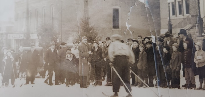 Harold Briggs, at the microphone, greeting skiers in front of Town Hall. (supplied)