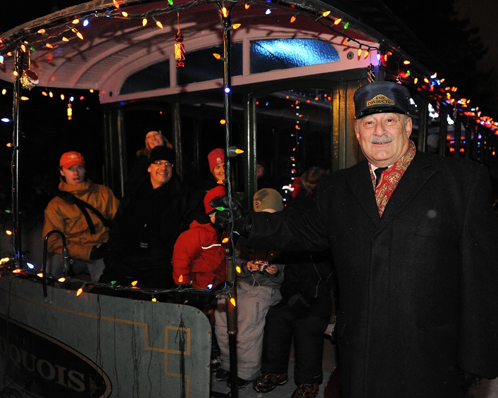 A helpful conductor ensures everyone gets to their seats safely (Muskoka Heritage Place)
