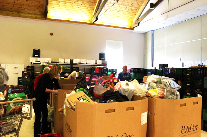 Volunteers continued to sort donations the day after the food drive