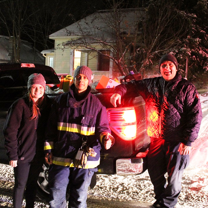 (From left) Tayler Calleja, Yasir Zelaya and Paul Calleja with a truckload of donations in downtown Huntsville
