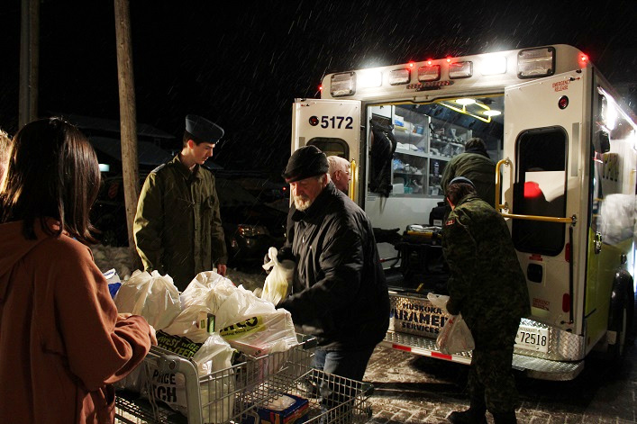 Waiting volunteers loaded donations into shopping carts, which were then moved inside to be sorted