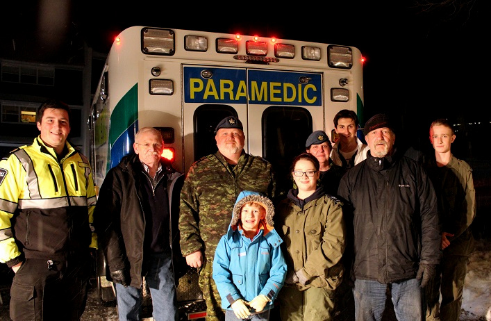 Many community members and local organizations help out, including the 844 Norseman Royal Canadian Air Cadets. (Back from left) Paramedic Michael Righetti, Norm Stapleford, Adam Smith, Pat Wilton, Logan Giampaoli, Richard Cusson, Nevan Cookson; (front from left) William Morrison and Emily Caine
