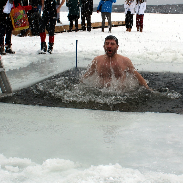 Huntsville Polar Bear Dip organizer Markus Latzel was the first to jump into the icy waters of Peninsula Lake