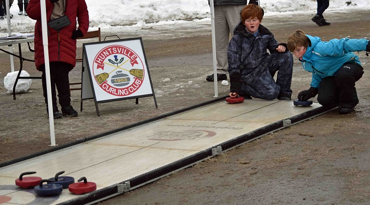 The Huntsville Curling Club brought a mini rink and rocks to the park - no sweeping required! (Cheyenne Wood)