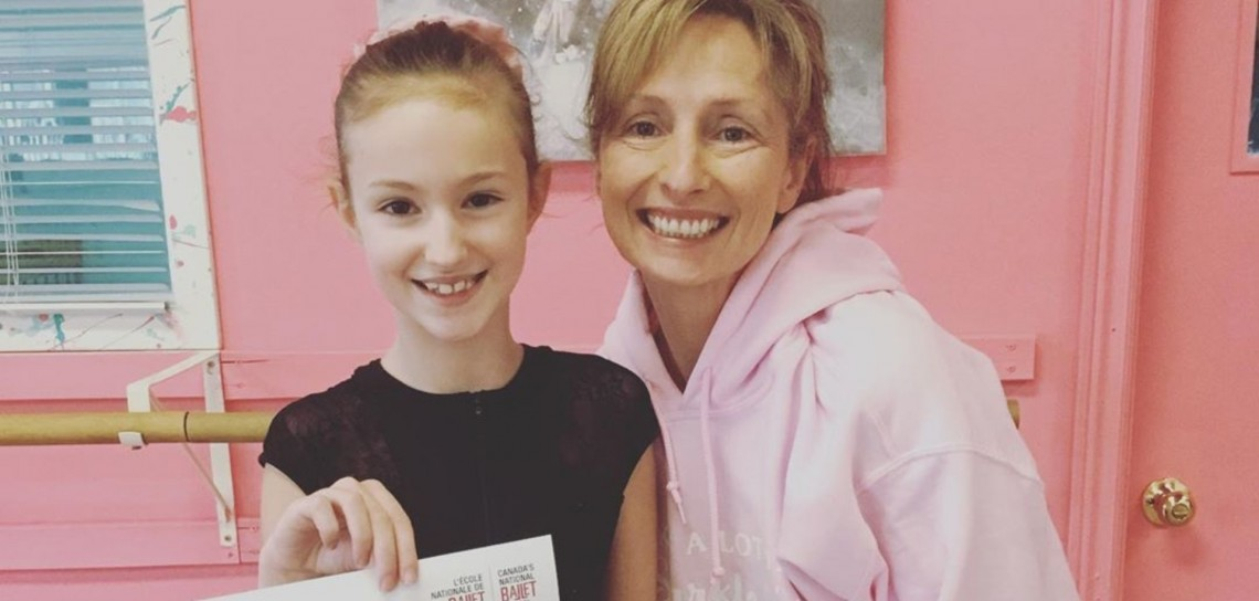 Ava Fuller (holding her invite to the National Ballet School summer intensive) with MDA owner Sue Kirwin-Campbell (@mda_dance / Instagram)