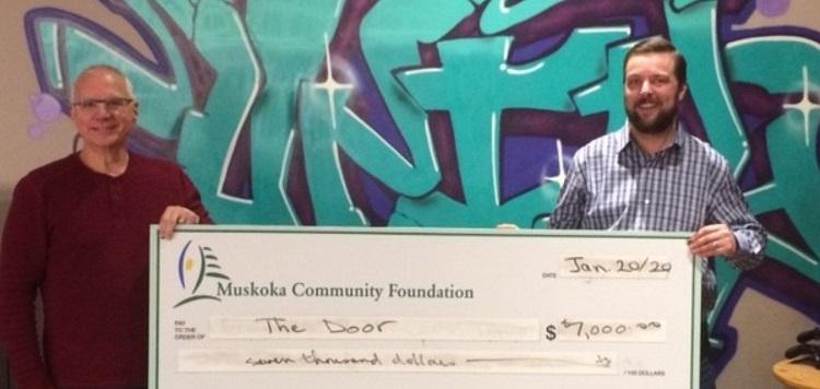 David Sprague (left), treasurer of the Muskoka Community Foundation presents a cheque to James Hunt, director of The Door (supplied)