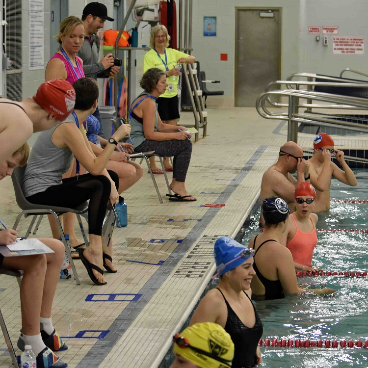 Swimmers await the start of their wave at the 2020 TriMuskoka Indoor Triathlon Winter Classic (Cheyenne Wood)