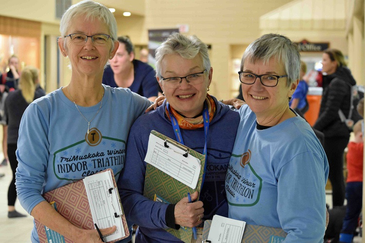 Long-time volunteers (from left) Joanne Osborne, Pam McDermott, and Kim Scott supported the who support the bikers as they spun away (Cheyenne Wood)