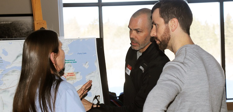 Nick Stoehr (centre) of TriSport talks about the proposed run route with a local resident (Don McCormick)