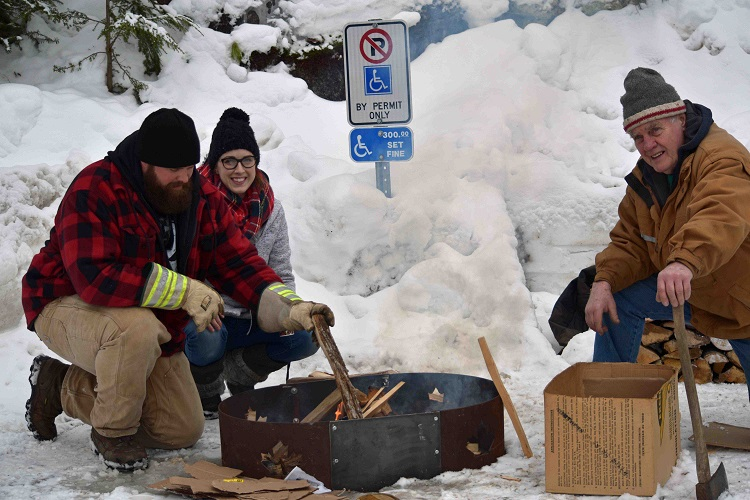 Lion Rob Hendry (left), his wife Alex Hendry and Lion Stan Stillar man the bonfire (Cheyenne Wood)