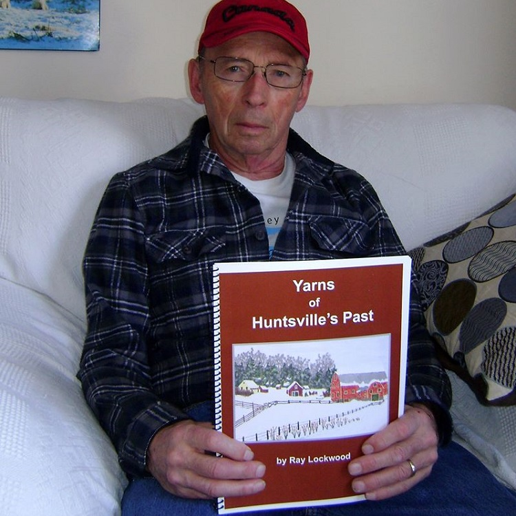 "Ray Lockwood holds a copy of his book ""Yarns of Huntsville's Past"" (Facebook)"