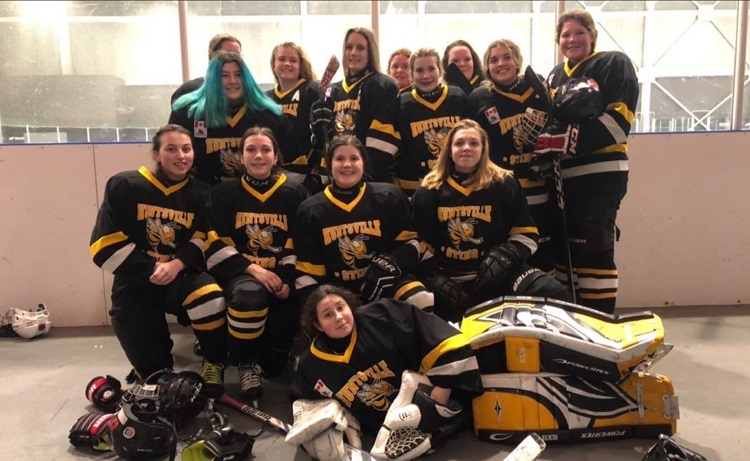 The Huntsville Sting Midget Black Robinson (back from left) Cassie Campbell, Lily Digiacomo, Avery Herr, Elina Robinson, Gabby Farr, Liney Luckasavitch, Emma Ralston, Eve Carreau, Olivia Maher; (front from left) Sienna Stetler, Asha Robinson, Kalei Huddlestone, Hannah Schnurr; and (lying in front) Evangeline Perentesis. Coaching staff (note pictured): Dale Robinson, Tom Farr, Glen Campbell, Steve Perentesis, and Vicky Perentesis.