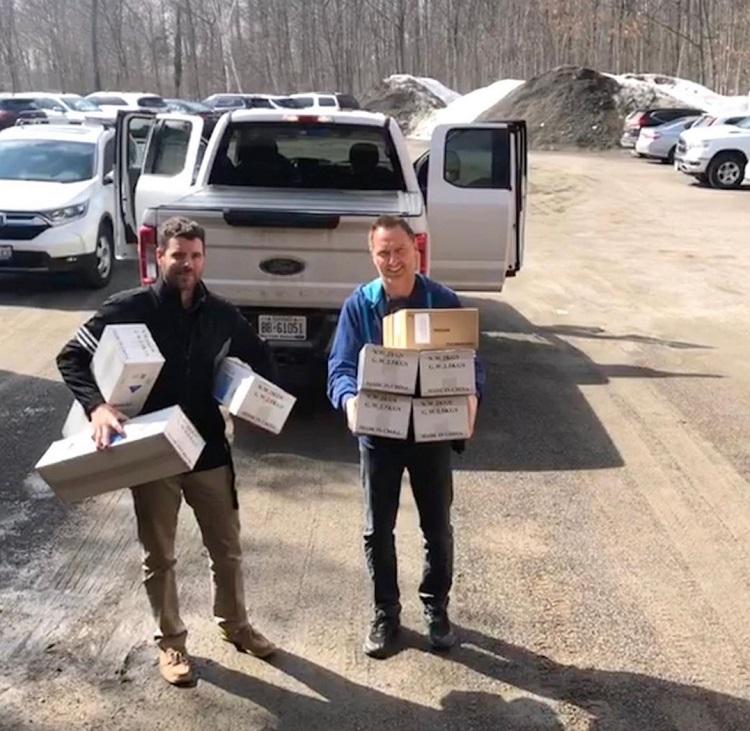 Andrew Buwalda (left) and Mark O'Dell of Deerhurst Resort drop off medical supplies at the Huntsville Hospital Foundation office on March 24, 2020 (@hhfmuskoka / Instagram)