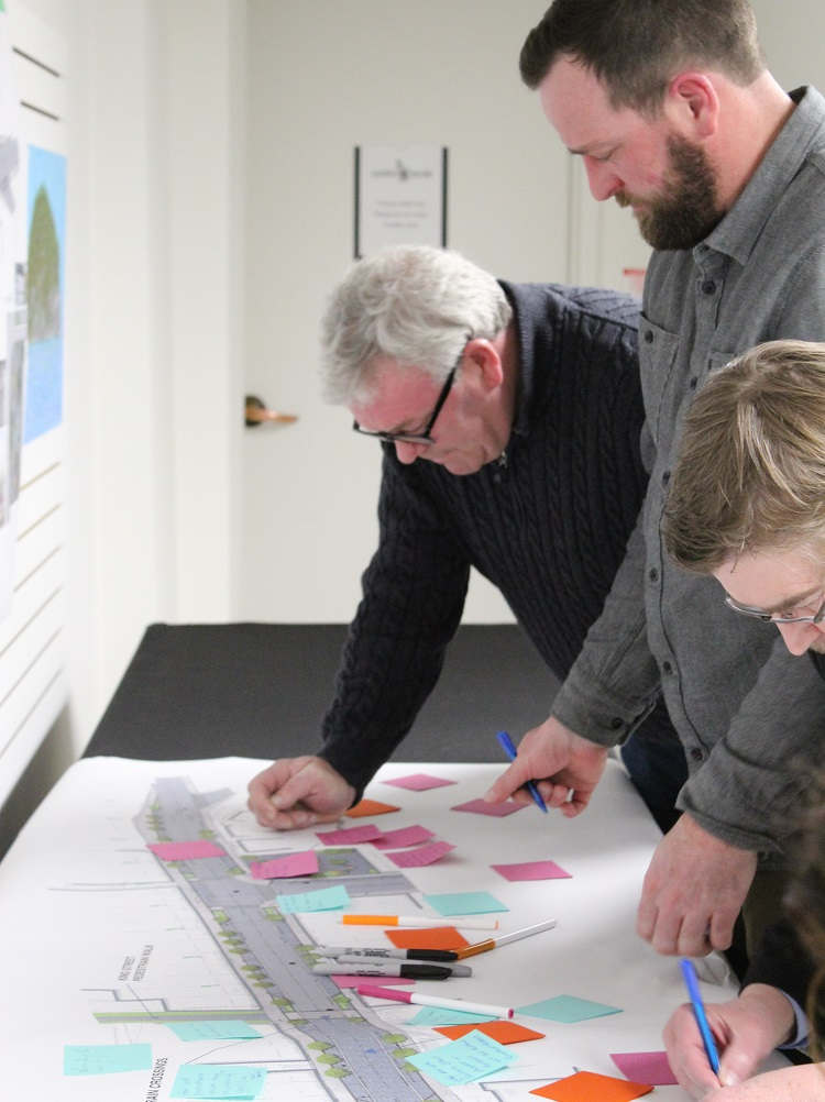 (From left) Councillor Jason FitzGerald, Nate Smith from Algonquin Outfitters, and consultant Les Ranta of EXP make notes about the streetscape design (Dawn Huddlestone)
