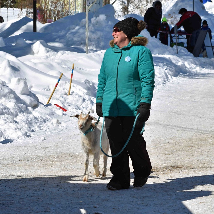 Stephanie Brooks takes Winter the goat for a walk (Cheyenne Wood)