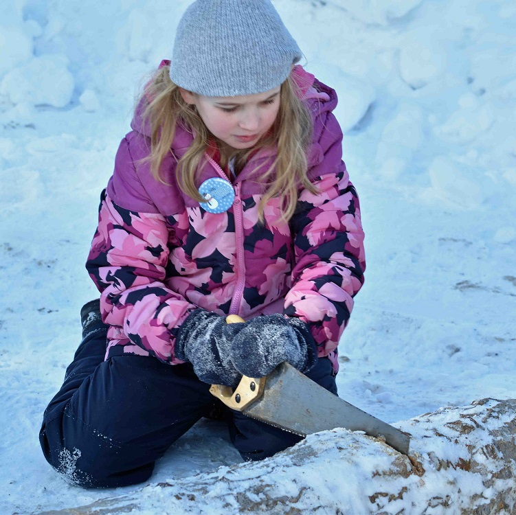 Log sawing was one of several traditional activities offered at the 50th Dwight Winter Carnival (Cheyenne Wood)