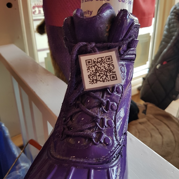 Each purple boot has a QR code so people can learn more about Hospice Huntsville (Dawn Huddlestone)