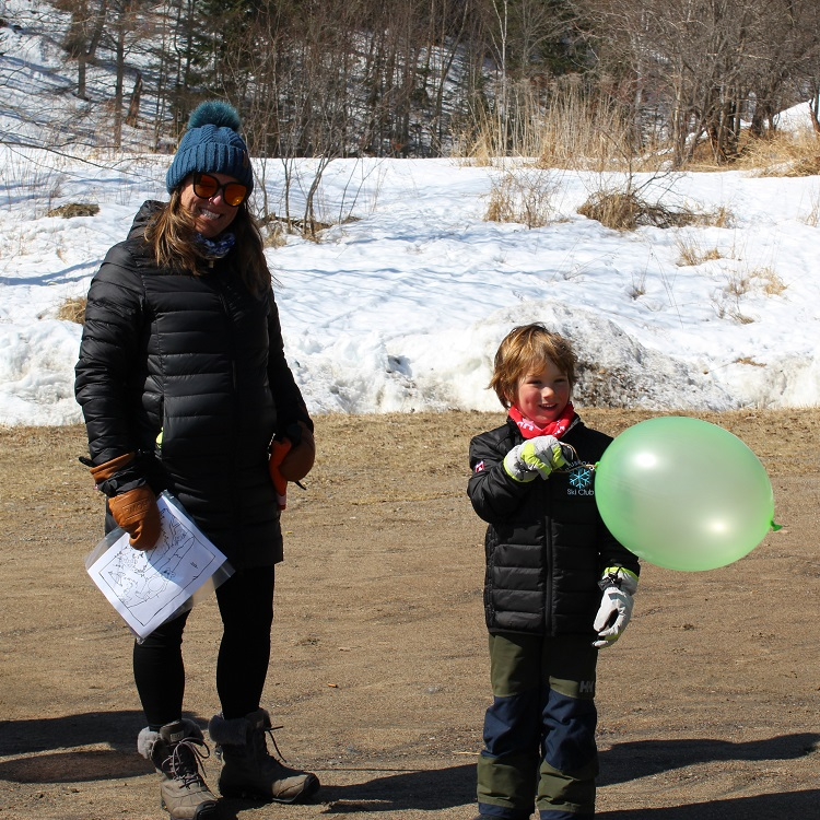 Jacob Repath (right, with mom Sheena) was excited to get a punch balloon and markers (Dawn Huddlestone)