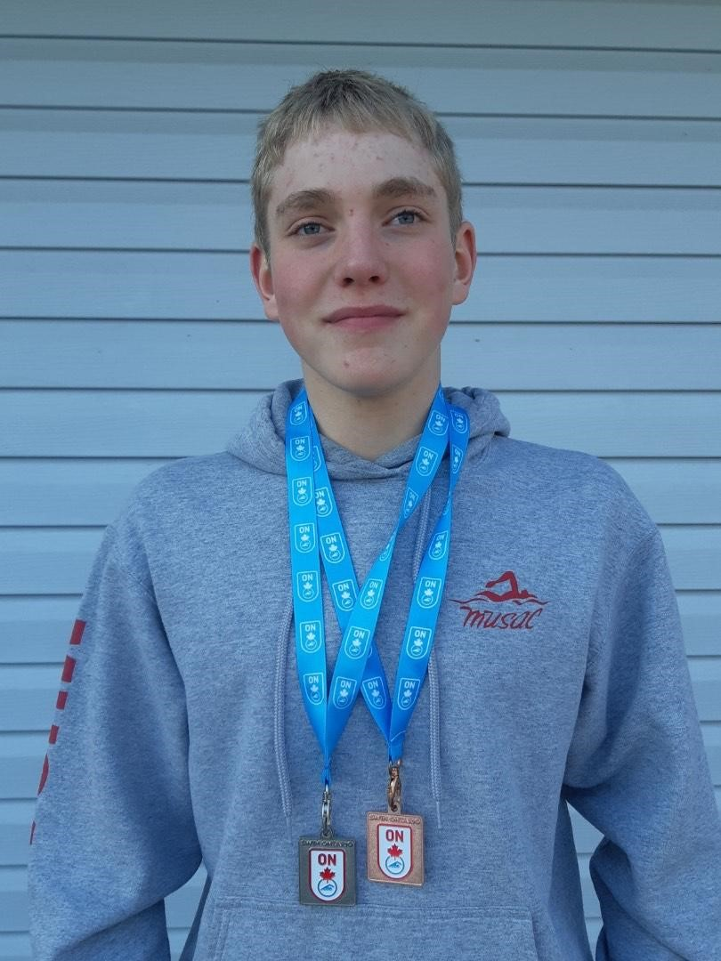 Matthew Kuusk with his silver and bronze medals from the Winter Ontario Youth-Junior Championships (supplied)