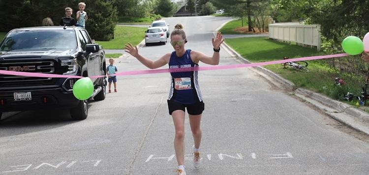 Kaitlyn Baker finishes her marathon (Don McCormick)