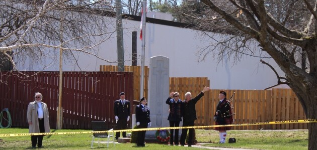 Marion and Rick Boddy wave thanks to supporters driving by the cenotaph at the Huntsville Legion