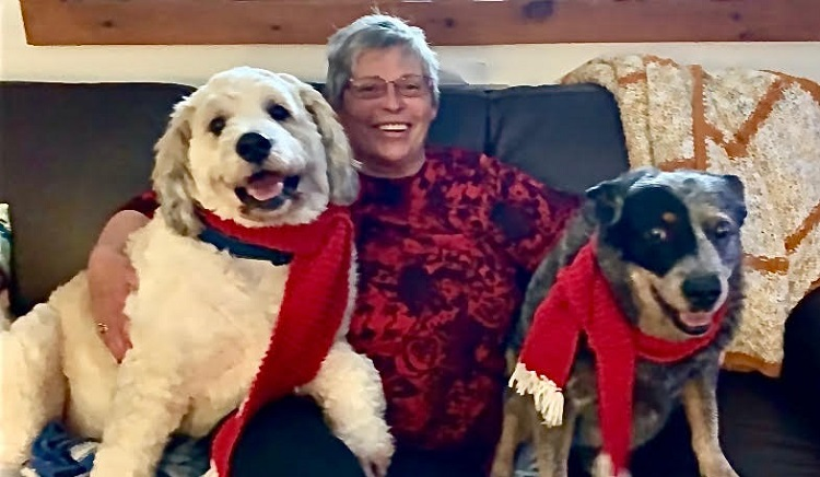 Knitter Liz Playford with Buddy and Shadow (supplied)