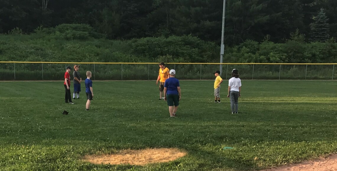 Muskoka Hornets 11U coach Travis Larade finishes up workout on opening night in one of two groups at Peake Field (supplied)