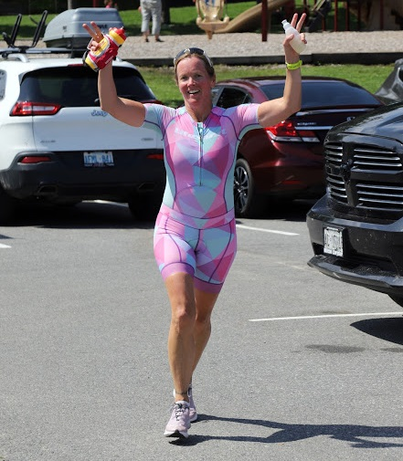 Jess Adam was all smiles at the River Mill Park parking lot, with the end of her 70.3-mile triathlon in sight (Don McCormick)