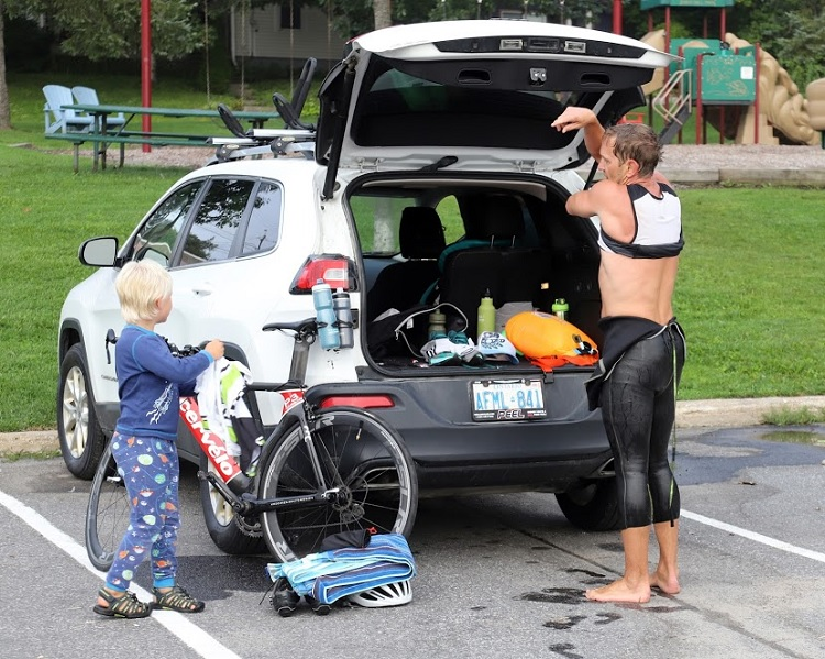 Luke Felhaber gets some help during his swim-to-bike transition (Don McCormick)