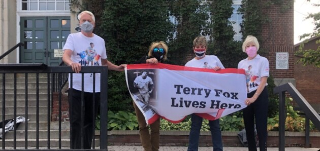 (From left) Steve Ainger, Mayor Karin Terziano, Sharon Stahls, and Anne Mundy with the Terry Fox flag at Town Hall (Sydney Allan)