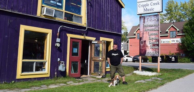 Mike McAvan and Gunner are ready to welcome old and new customers to Cripple Creek Music (Mandi Hargrave)