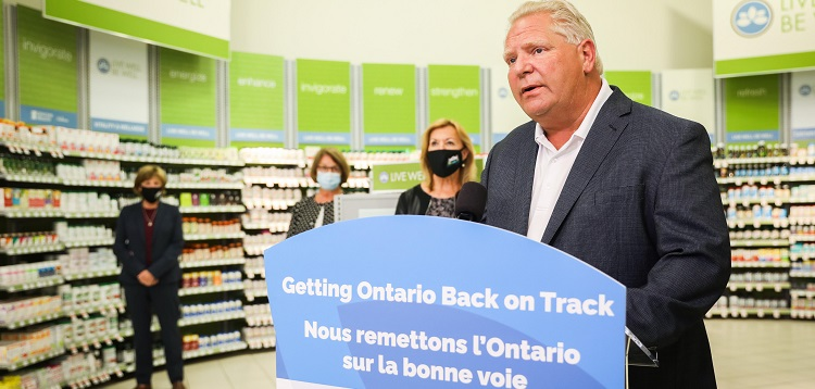 Premier Doug Ford (foreground) and Minister Christine Elliott made an announcement about testing at Shoppers in Huntsville today (Photo courtesy of the Premier's Office)