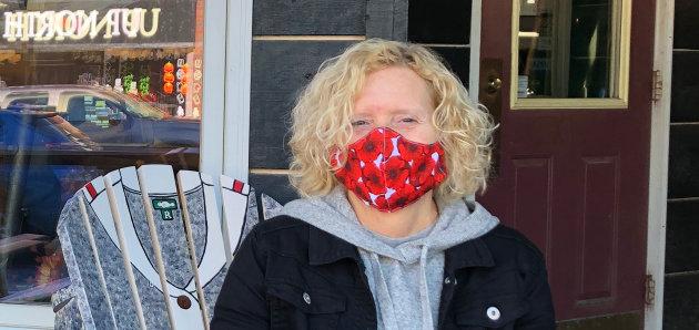 Kathy Sheridan of Reflections of Muskoka sports a poppy mask made by Huntsville Legion volunteers (Sydney Allan)