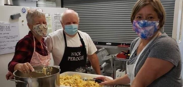 (From left) Rose Evans, Nick Paroschy, and Christine Kropp make perogies (supplied)