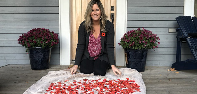 Huntsville resident Aimée Bulloch-Moore with some of the ceramic poppy pins created by students (Sydney Allan)