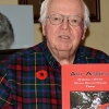 Doug Cunnington with the book he wrote about his uncle, Art Asbury (supplied)