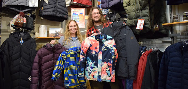 Heather Cassie and Randy Mitson in 2019 with some of the coats donated for last year's drive (supplied)