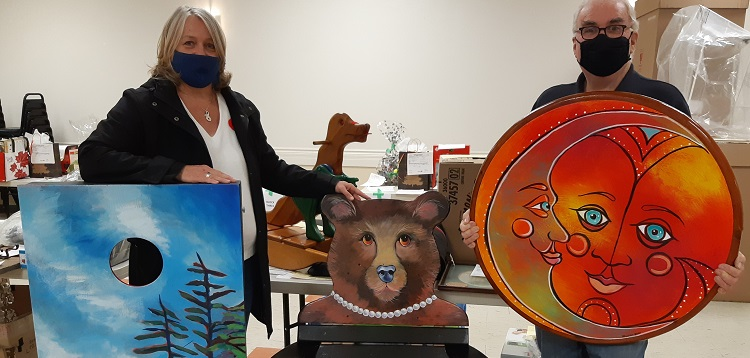 Helena Renwick (left) and Ross Kirwin with some of the items available in the 2020 Rotary auction (supplied)