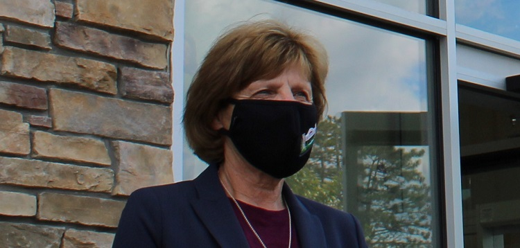 Mayor Karin Terziano wears a Town of Huntsville mask at a Premier Ford media conference in September (file photo)