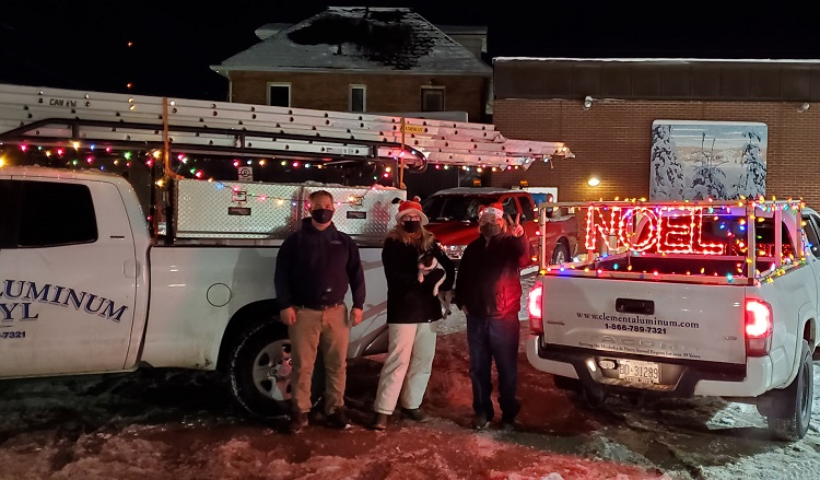 Joe Standing 'Lady Liana' with Ladybug and 'Muskoka Mike' dropped off donations in festively decorated trucks from Clement Aluminum and Vinyl (Dawn Huddlestone)