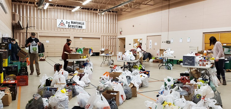 As more and more vehicles unloaded, the gym at Trinity United Church began to fill up with donations (Dawn Huddlestone)