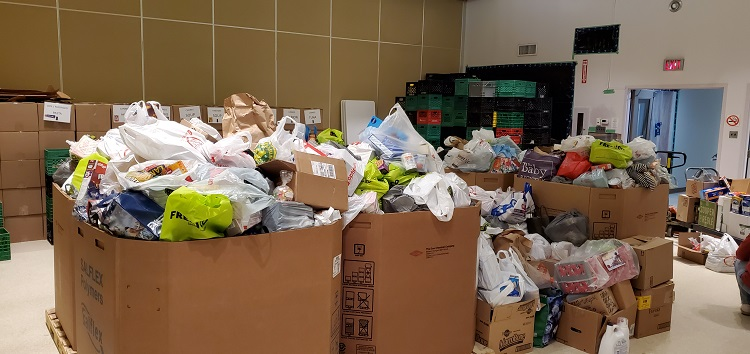It didn't take long for boxes at the Salvation Army to overflow with donations waiting to be sorted (Dawn Huddlestone)