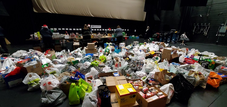 Donations covered most of the Algonquin Theatre stage while volunteers rushed to sort them (Dawn Huddlestone)